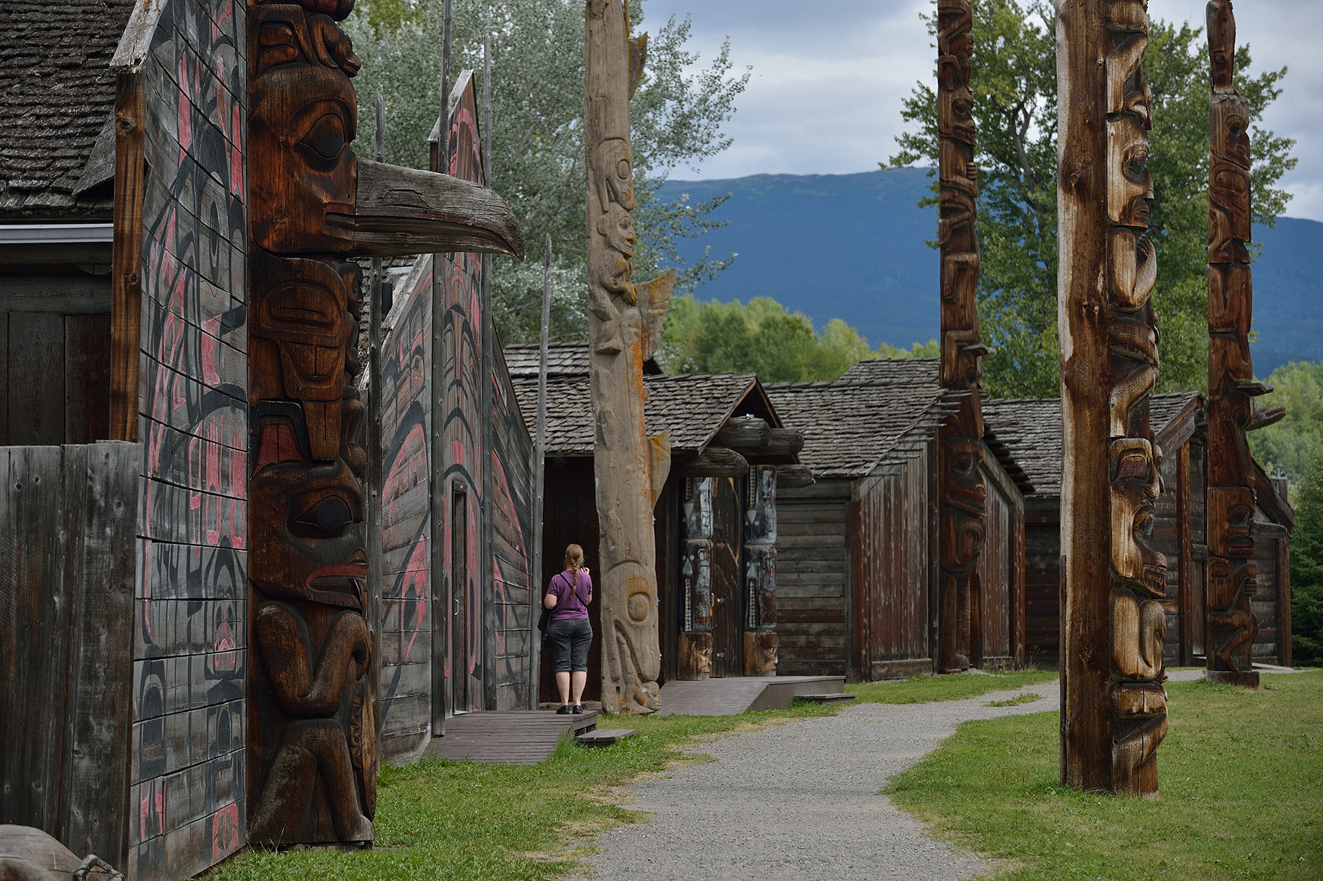 A woman exploring a historical site in British Columbia's Highway 16