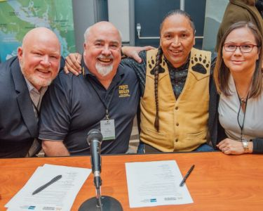 ITBC and Tourism Vancouver Island members smile after signing an MOU