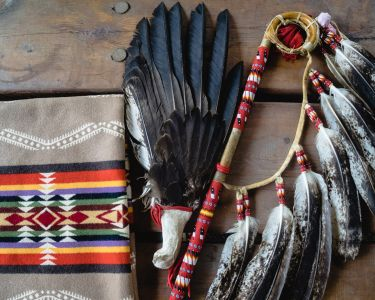 A collection of traditional Indigenous items laid on wooden boards.