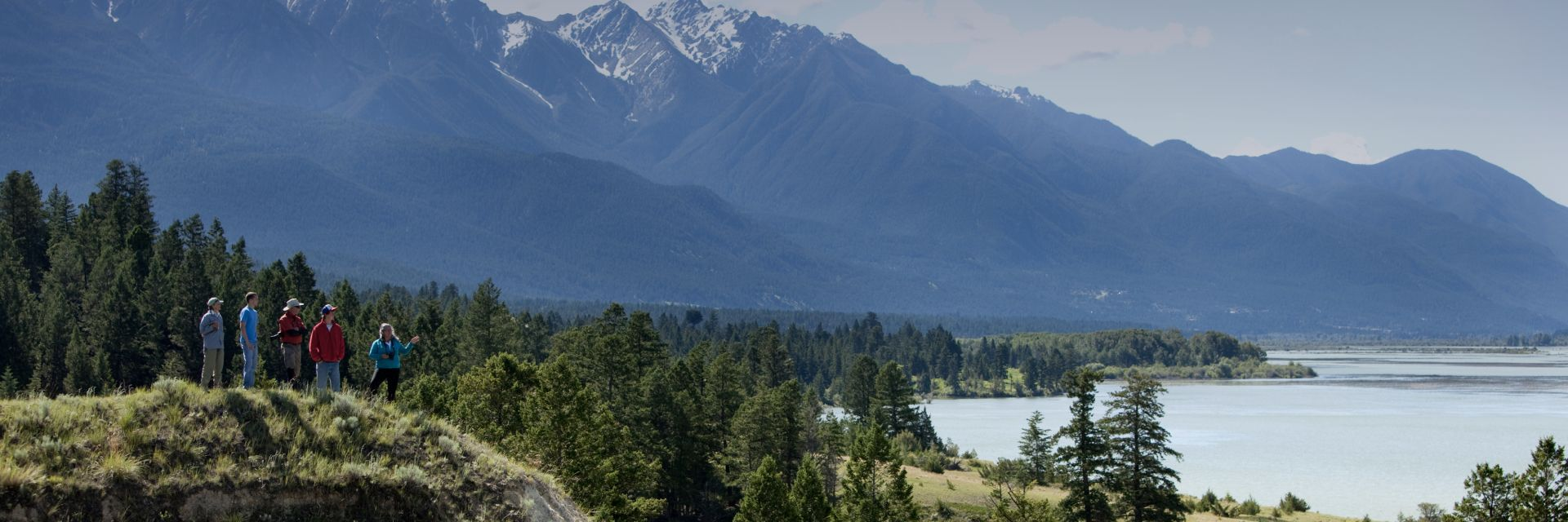 A landscape view of the Kootenay River and Kootenay Rockies in the distance