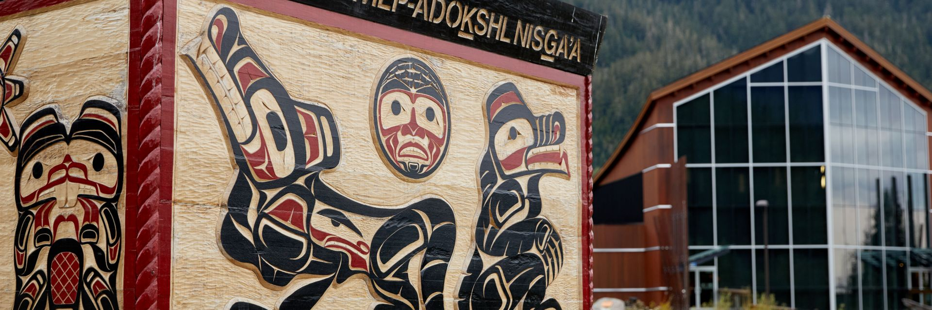 A closeup of the sign for the Nisga'a Museum