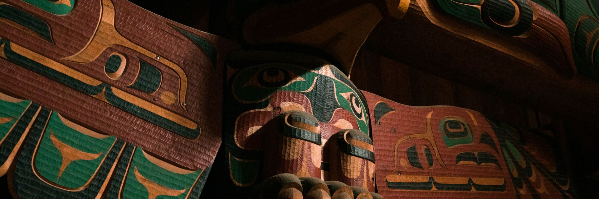 A closeup shot of a totem pole.