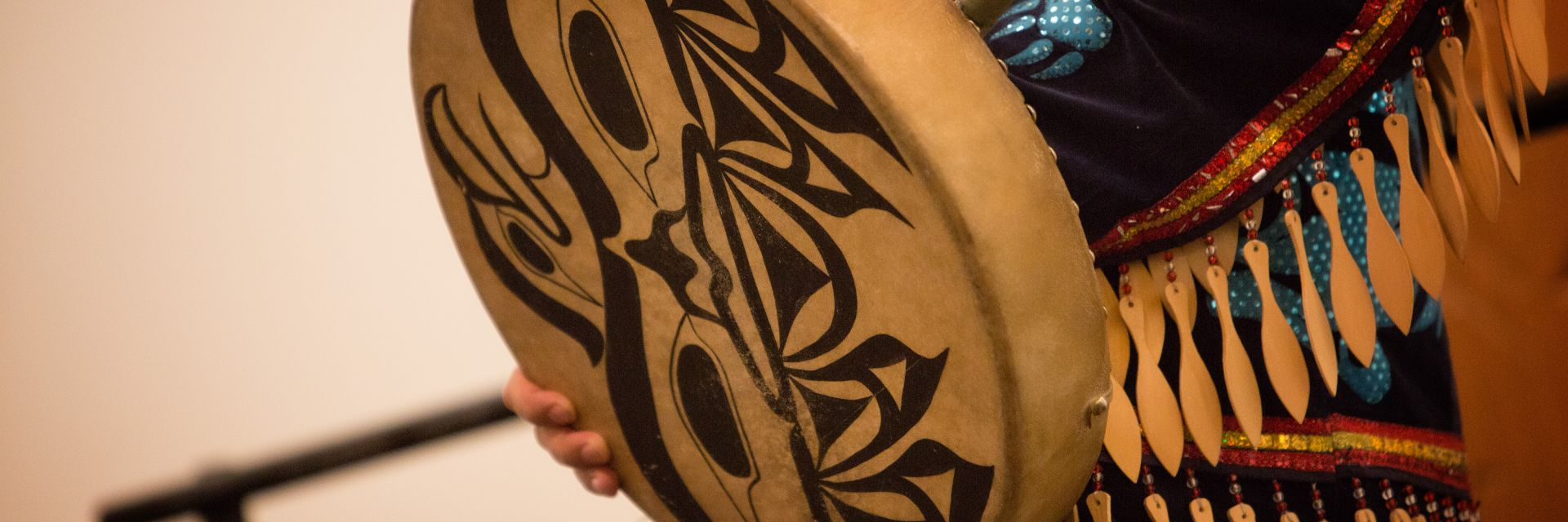 A closeup of an Indigenous drum with intricate black designs